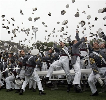 Cadets toss their hats in the air at the completion of a graduation  ceremony at the United States Military Academy at West Point 8841c7127773